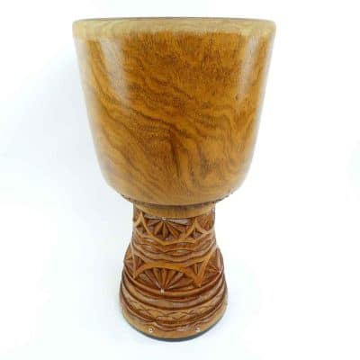 This Master Series Djembe is hand carved from Khadi timber. Khadi, or hare, is the densest and hardest of West African timbers, known for powerful resonance and its signature tiger grain. Instantly recognisable and highly sought after. Many different carving styles give it a wide spectrum of sound.